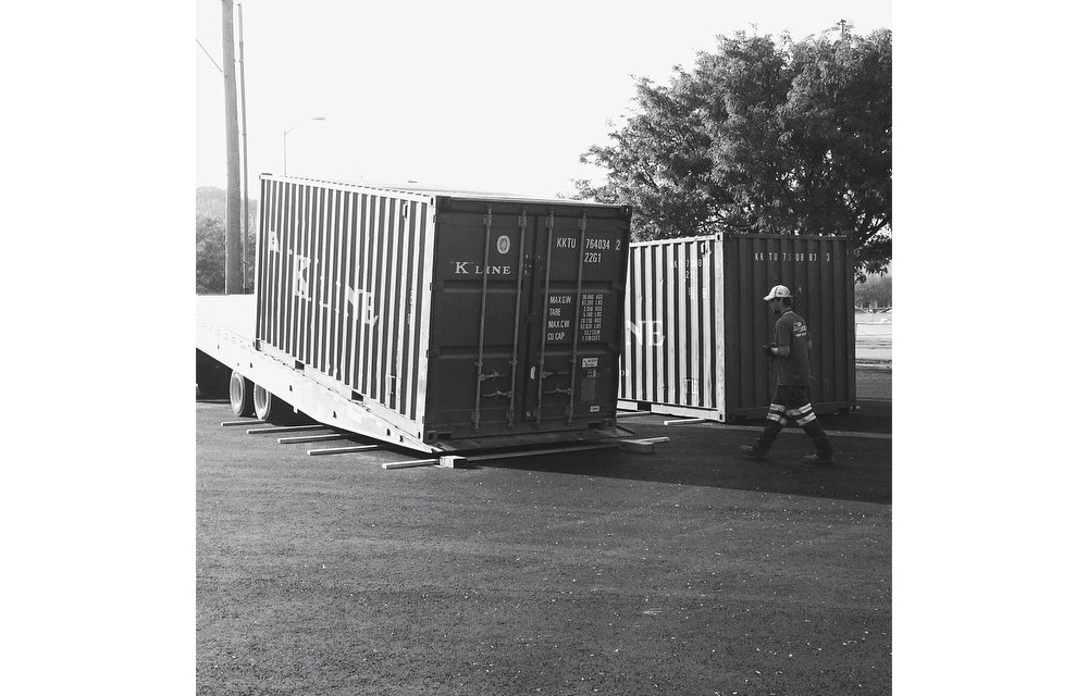 Shipping containers arriving at the site. Image: 50/50.