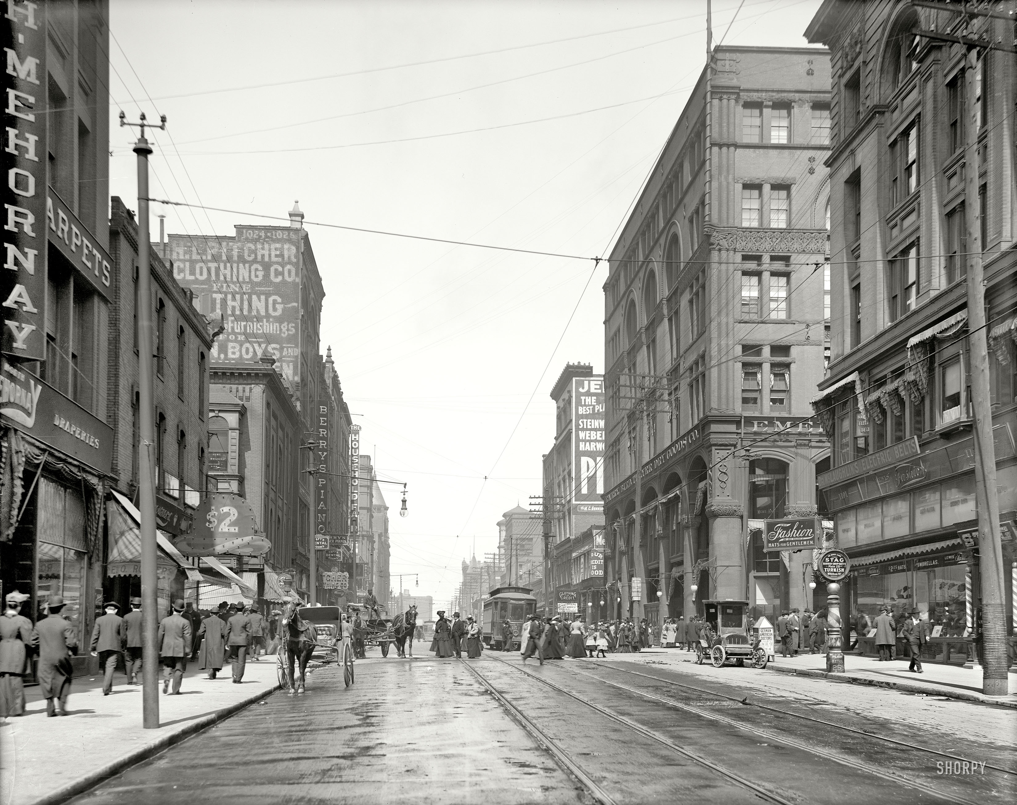 Historic image of people walking on a street