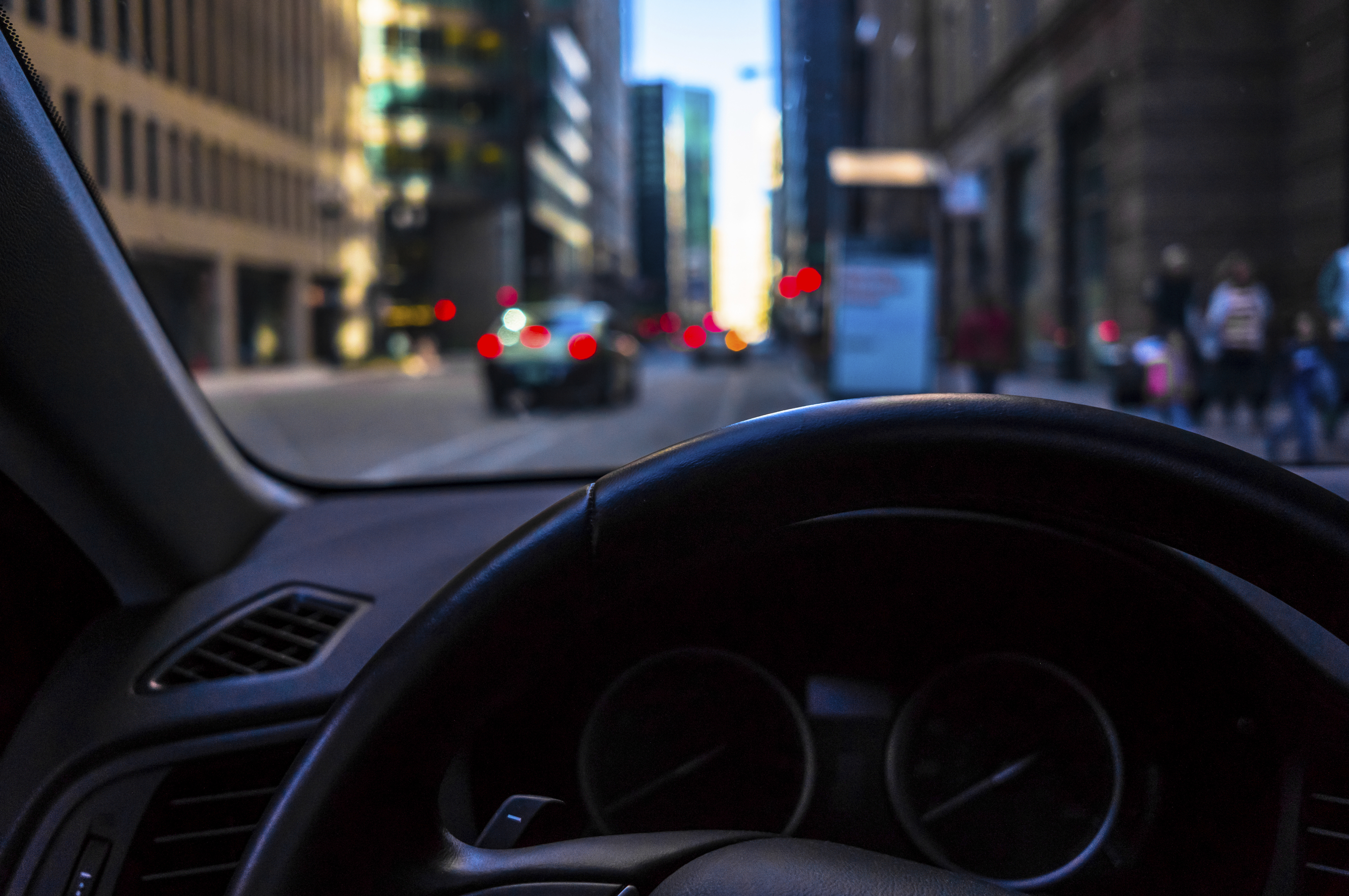 urban street - view from inside a car